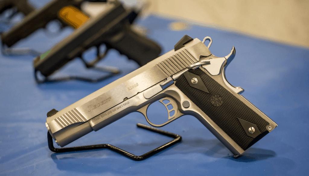 row of metal pistols