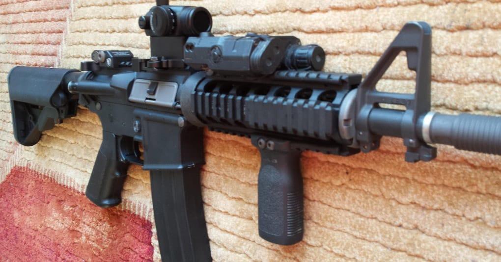 black rifle sitting on rug