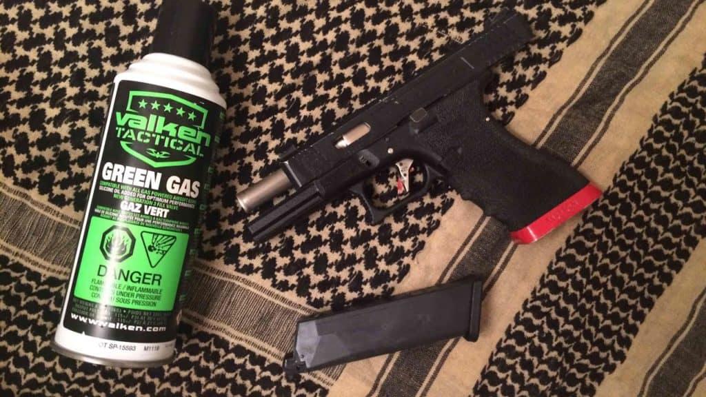 green gas pistol on table